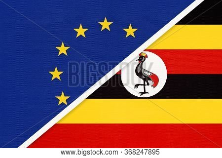 European Union Or Eu And Uganda National Flag From Textile. Symbol Of The Council Of Europe Associat