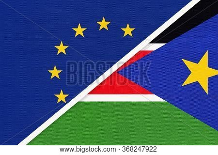 European Union Or Eu And South Sudan National Flag From Textile. Symbol Of The Council Of Europe Ass