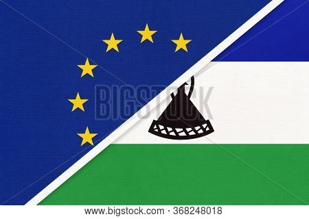 European Union Or Eu And Lesotho National Flag From Textile. Symbol Of The Council Of Europe Associa