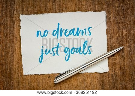 no dreams, just goals motivational note - handwriting on a handmade rag paper, goal setting, focus and determination concept