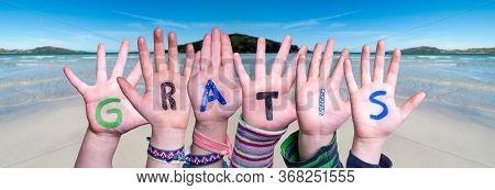Children Hands Building Word Gratis Means Free, Ocean Background