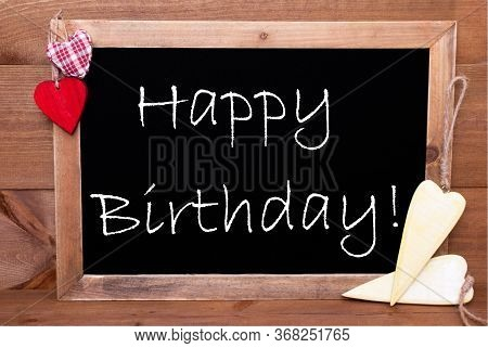 Balckboard With Heart Decoration, Text Happy Birthday, Wooden Background