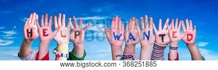 Children Hands Building Word Help Wanted, Blue Sky