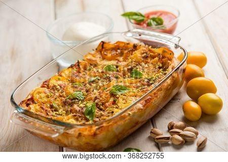 lasagne with mozzarella fresh tomatoes and pistachio nuts