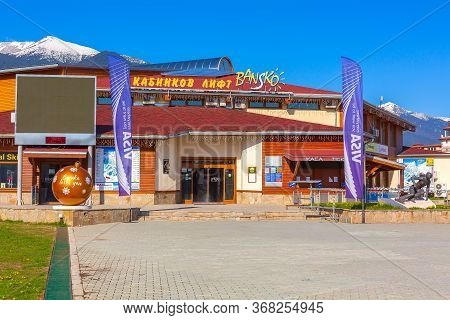 Bulgaria, Bansko - May 5, 2020: Big Yellow Ball Bansko Loves You Near Gondola Station, Skier Statue