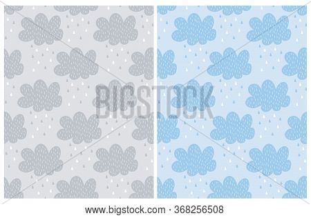 Seamless Vector Patterns With Blue And Gray Hand Drawn Clouds. Cute Fluffy Clouds On A Light Blue An