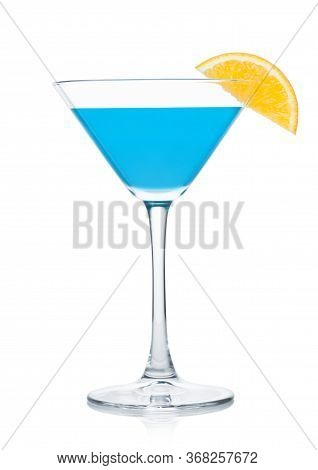 Blue Lagoon Summer Cocktail In Martini Glass With Orange Slice On White Background.