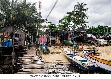 Mabul Island, Sabah, Malaysia - August 08, 2018: A Floating Village At Mabul Island. With Small Boat