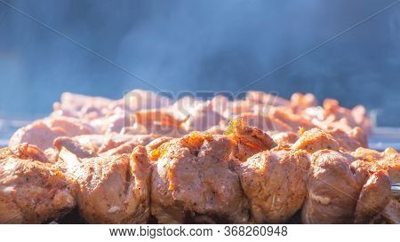We Fry Shish Kebabs, Barbecue, Bbq In The Backyard In The Summer On A Weekend. The Chef Prepares Mea