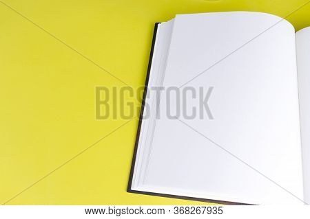 Empty Book Booklet Mockup With Blank Pages And Copy Space On Yellow Background. Top View. Template F