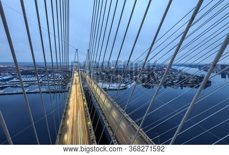 Cable-stayed bridge in Saint-Petersburg, Russia, aerial industrial cityscape