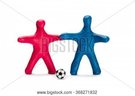 Plasticine small persons soccer red and blue players with ball isolated on white