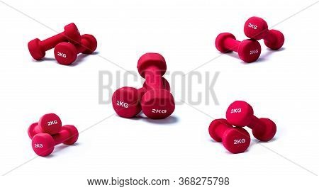 Set Of Red Dumbbells Isolated On White Background. A Pair Of Red Neoprene Dumbbells. Home Gym Equipm