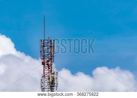 Telecommunication Tower With Blue Sky And White Clouds. Worker Installed 5g Equipment On Telecommuni