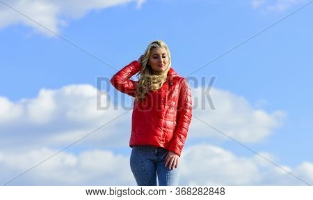 Female Psychology. Girl Red Jacket Cloudy Sky. Wind Of Changes. Woman Fashion Model Outdoors. Woman