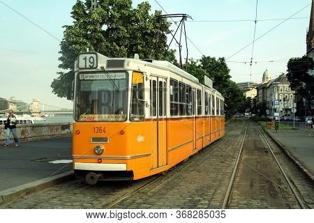 Budapest, Hungary - June 13, 2008: Budapest Tram, Or Called Villamos, Ganz Csmg, On A Stop In Buda D