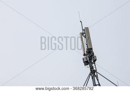 Mobile Phone Base Station, Equiped With 3g, 4g And 5g Antenna, At The Top Of A European Building, Us