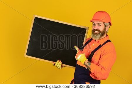 Architect Demonstrating Project. Professional Repairman. Visual Outline. Handsome Repairman. Price L