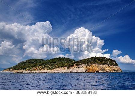 Landscape With The Sea, Island And Beautiful Clouds In The Blue Sky. Kelifos Island, Aegean Sea, Hal