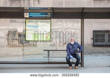 Belgrade, Serbia - April 23, 2020: Old Senior Man Wearing A Respiratory Face Mask Waiting For Transp