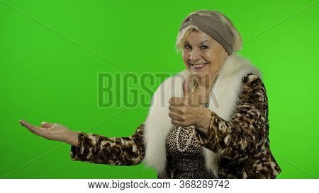 Elderly Style Granny Caucasian Mature Woman Pointing At Something With Hand On Chroma Key Background