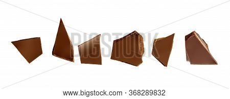 Chocolate Pieces And Shavings Isolated On White Background. Chunks Of Dark Chocolate Falling Close U