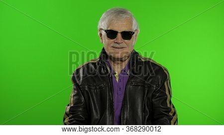 Elderly Stylish Grandfather Caucasian Rocker And Biker Mature Man In Sunglasses On Chroma Key Backgr