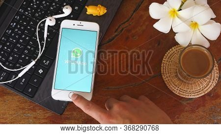 Chiang Mai, Thailand - May 22, 2020 : Person Holding Iphone 6s With Whatsapp Logo On The Screen. Wha