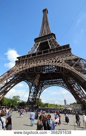 Paris, France - July 25, 2011: People Visit The Eiffel Tower In Paris, France. Eiffel Tower Was The
