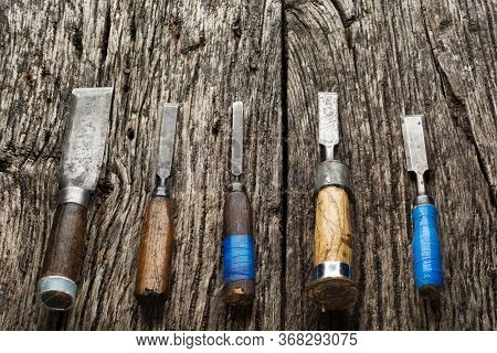 Carpenter Tools Composition. Old Carpenter Chisels Laying On Rustic Wooden Table Upper View