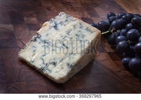 A Piece Of Stilton Blue Cheese With Sable Grapes