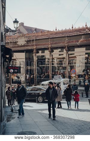 Madrid, Spain - January 26, 2020: People Walk Outside Mercado De San Miguel (