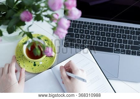 Home Office Workplace. Woman Planning Working Schedule Writing In Notebook At Working Place With Lap