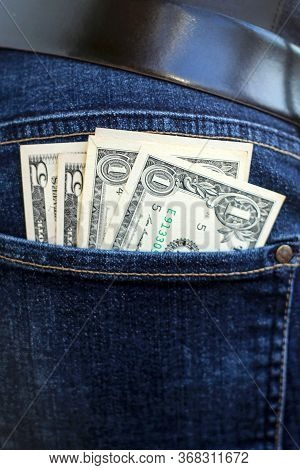 Banknotes Of  Dollars Sticking Out Of The Jeans Pocket