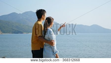 Couple look at the sea view at outdoor