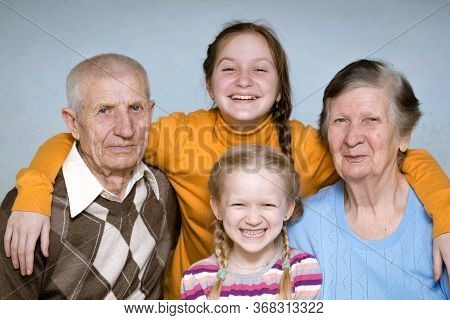 Portrait Of A Great-grandmother, Great-granddaughters And  Grandfather, Close-up