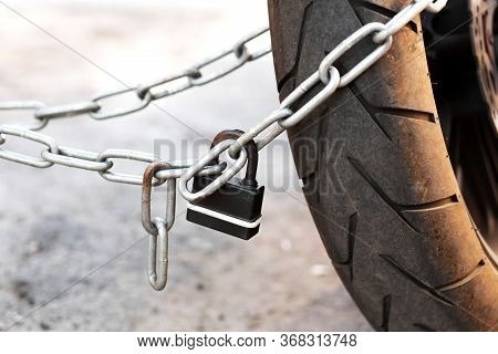 Anti-theft System Of The Bike. Fasten The Bike To The Pole.