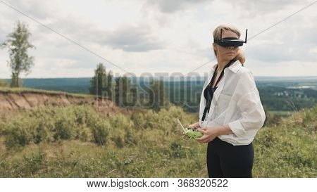 Girl Puts On Black Fpv Goggles To Control The Drone