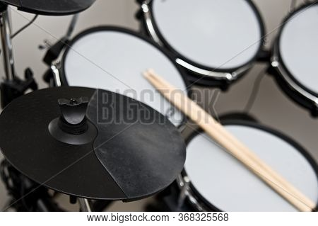 Closeup Of A Modern Elecgtronic Drum In Black Color.