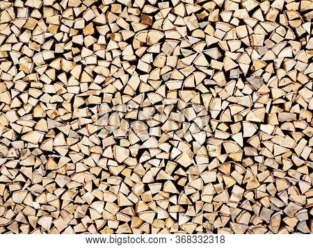 Woodpile With A Lot Of Birch And Spruce Logs. Chopped A Lot Of Firewood Neatly Stacked In A Pile, Ba