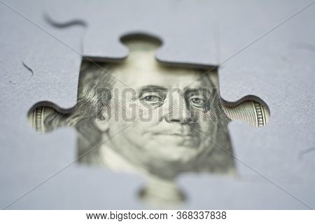 Fragment Of Portrait American President Benjamin Franklin From A Hundred Dollar Banknote Bill. View