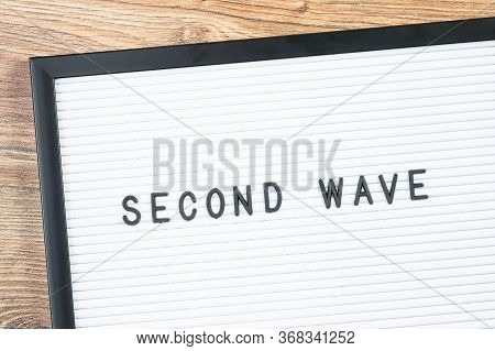 Second Wave Text On White Letter Board On Wooden Desk. Warning Sign Or Newspaper Caption. Second Wav