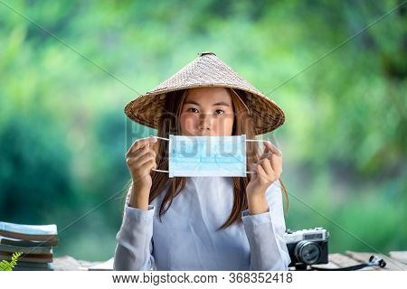 Asian Young Woman Wear Medical Face Mask,vietnam Woman Wearing Ao Dai Culture Traditional,travel And
