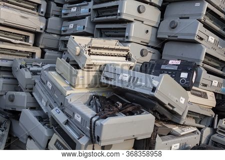 Kyiv, Ukraine -  April 20, 2019: Pile Of Dot Matrix Printers And Other Obsolete Used Equipment On Th