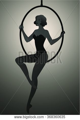 Backlit Silhouette Of Woman Trapeze Artist Sitting On A Hoop Suspended In The Air