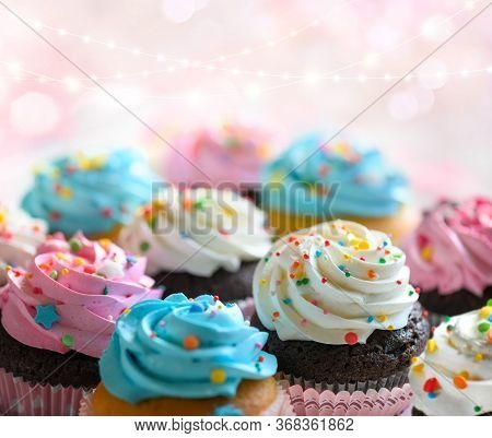 Festive Delicious Cupcakes For Party, Birthday. Various Cupcakes With Pink White And Blue Cream On P