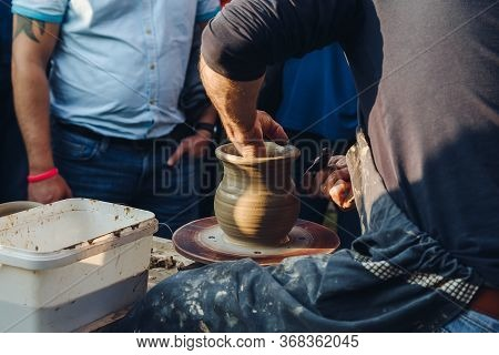 Potter Ceramist Creat Jar On Lake Baikal