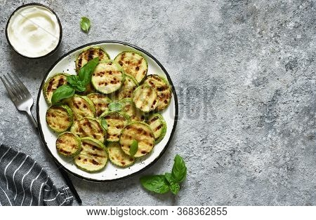 Grilled Zucchini With Sauce On Concrete Background. View From Above.