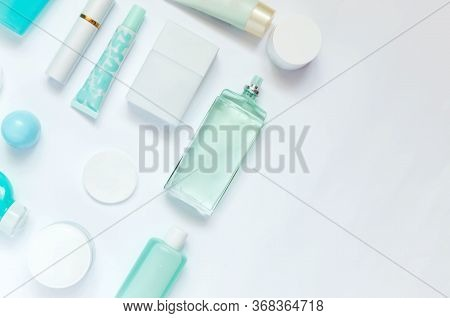 Daily Care Cosmetics On White Background. Flat Lay Composition With Blue And White Dispenser, Bottle