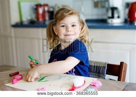 Little Toddler Girl Painting With Felt Pens During Pandemic Coronavirus Quarantine Disease. Happy Cr